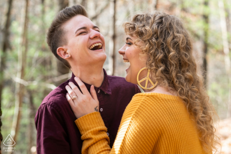Helen, Georgia Engagement Photography Session - Image contains:peace sign, earrings, laughing, trees, forest