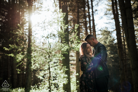 Couple session in the mountains of the Sila national park, Calabria | Image contains: hug, embrace, love, forest, trees, woods, sunlight