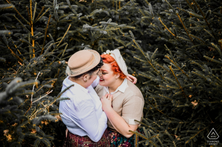 Netherlands Appelscha Engagement Photography - Image contains:pine, trees, couple, hats