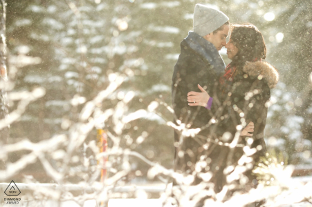 West Lake Tahoe Couple snuggling in the snow   Engagement Picture Session - Portrait contains:winter, jackets, beanie, hoods