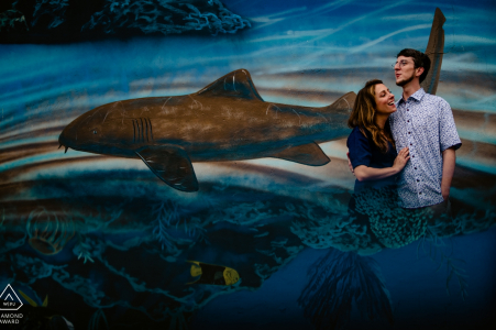 Waterfront Brewery, Key West, Florida Couple Portrait Photographer: really cool mural, but has really bad foreground. reflected the mural into my cell phone below lens to create the illusion that couple was inside the waterscape