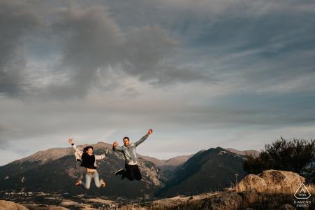 Bolquère, Pyrénées-Orientales, France Jumping couple during engagement prewedding portrait shoot session.