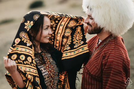 Franco-Turmenistan engagement session in the French Pyrénées with traditional clothing.