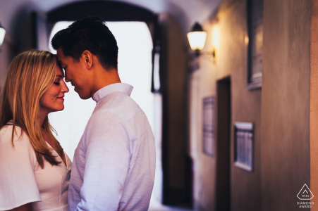 Montepulciano - Tuscany - Italy pre wedding photographer: a romantic moment in Montepulciano with an engaged couple about to kiss