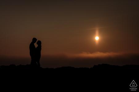 St Ouens, Jersey , CI engagement portrait session | the couple get close at sunset