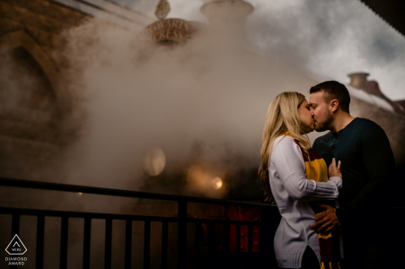Universal Orlando Resort, Orlando, Florida Engagement photographer: Using the steam from the train to create a backdrop, which created the same feel for the surroundings. we only had 1 shot at this and were lucky on the first image