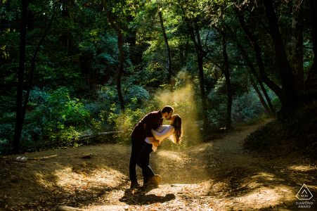 Henry Cowell Redwoods State Park Couple kissing in a pocket of natural light/dust