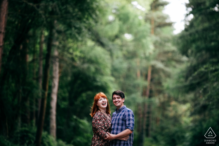 Irchester Country Park Pre-Wedding Shoot | Happy engaged couple laughing during engagement session
