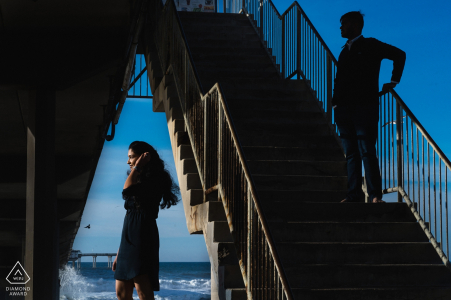 San Diego, Ca Couple artistically placed in the oceanfront frame - Engagement Photography
