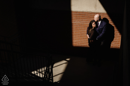 The Pearl Brewery Engagement Photo Session | Couple in the light with angled shadows in a parking lot