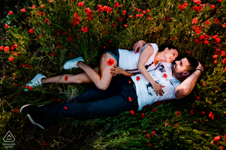 Sofia-Bulgaria Pre wedding portrait shoot with a couple lying down in a field of flowers