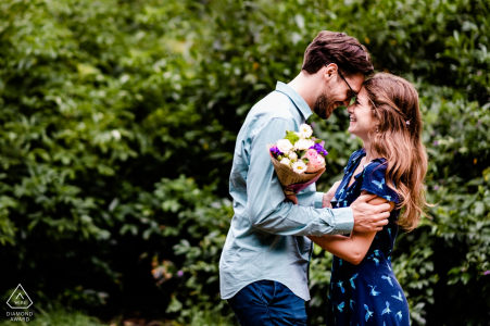 Sofia-Bulgaria engagement photographer: Pre wedding shoot for my clients with a bouquet of flowers