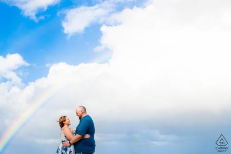 El Morro, San Juan PR prewedding portrait photographer: Perfect timing with a rainbow, just one light over couple