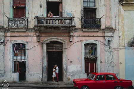 Cuba engagment shoot in the streets with a red car.