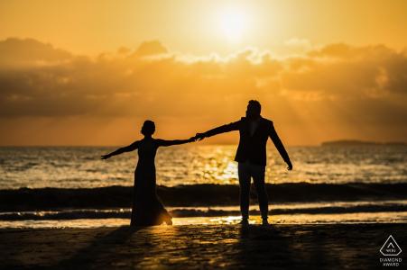 W Punta Mita Resort, Punta Mita, Mexico engagement shoot | Photo includes: couple, silhouette, water, sunset, dancing
