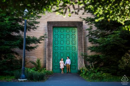 San Francisco Engagement Shoot - Couple Holding hands by big green door.
