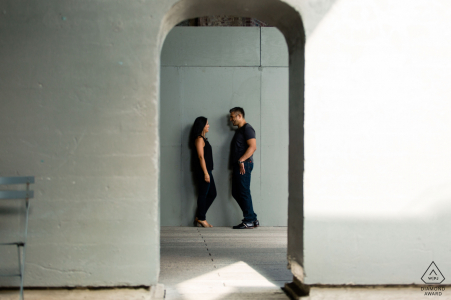 The High Line Park, NYC engagement image of a couple shot through and framed by a doorway.