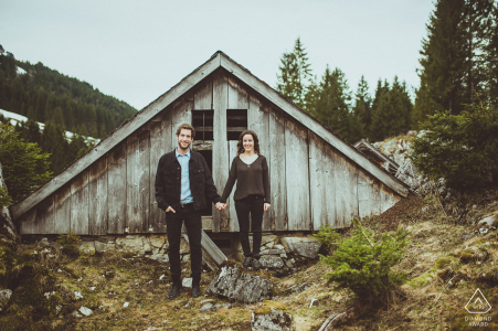 Engagement shooting in the Swiss Alps of a couple holding hands.