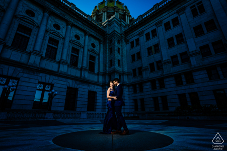 "Harrisburg Engagement Portrait | Photographer: ""It was a very overcast day and this area was on the backside of the building in total shade. I used a 1/4 CTO gel to help push the overall scene even more blue while correcting for the couple's skin tones"""