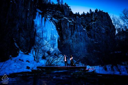 Rifle Falls, CO couple picture - walking across frozen river in winter