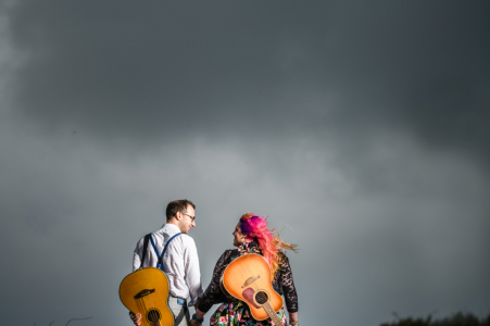 Pleinmont, Guernsey Engagement Image - Couple with guitars and approaching storm