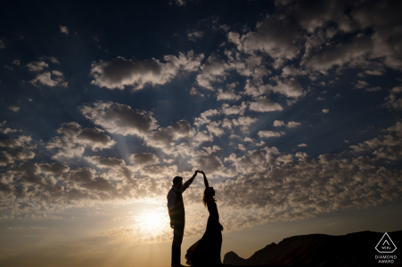 Fossil Rock, Dubai Desert Couple Dancing in the Desert under the Clouds and Blue Sky