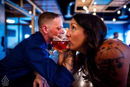 Engaged Couples Photography | Sanitas Brewing, Boulder, CO - An engaged couple drink beer, arms linked