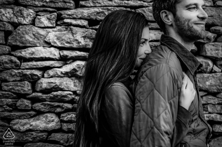 A couple set in front of a stone covered wall in Lyon, France for a prewed engagment shoot