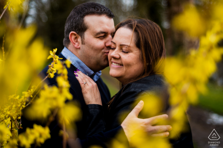 Engaged couple embrace each other during a portrait session at Rushton Hall Hotel and Spa