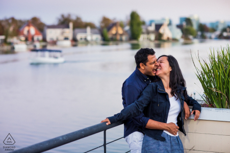 Fun time by the lake of a couple during  a portrait shoot in Foster City