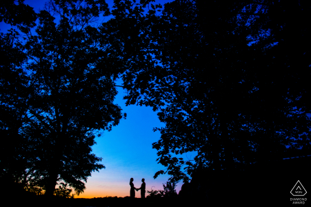 Great Falls National Park engagement portrait of a couple at sunset