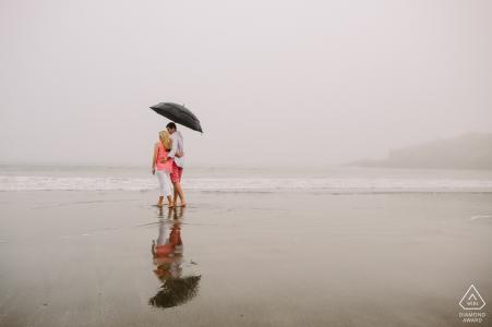 Romance in the Rain during a beach portrait session in York Harbor Beach, York Maine