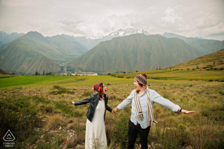 engaged couple enjoying the gorgeous hills of Cusco and the Sacred Valley during their portrait session