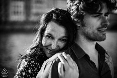 Auvergne-Rhône-Alpes hugging couple engagement portrait in black and white