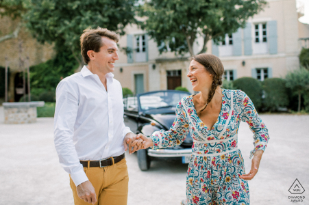 A nice couple in front of an old vintage car in Provence