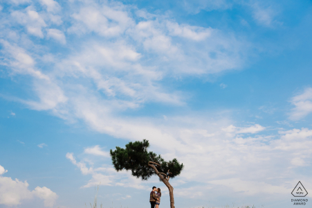 Dalat Pre-Wedding portrait session with a lone tree, the sky and clouds