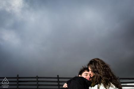 A cloudy snow mountain couple portrait session in Puerto de Navacerrada, Madrid Spain