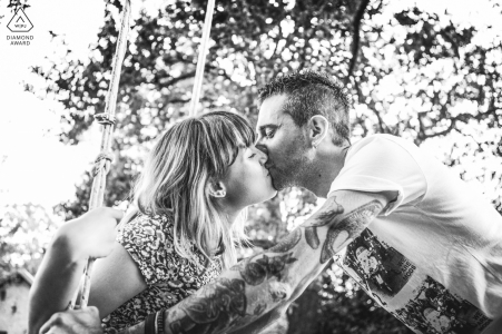 a swinging embrace for this engaged couple during a Predappio, Forlì-Cesena, Italy engagement photoshoot