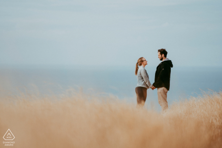 engaged Couple together by the water during their Godley Head, Christchurch NZ portrait session