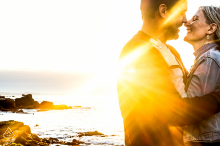 Noordhoek, Cape Town engagement photographer Making use of the rising sun for this intimate photo of the engaged couple.