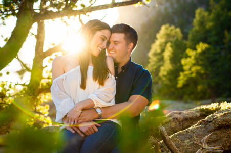 The couple embrace during their engagement session at Eleven Mile Canyon in Lake George, Colorado.