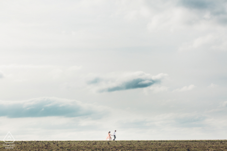 Country side around Paris Engagement shooting before wedding under the big sky and clouds