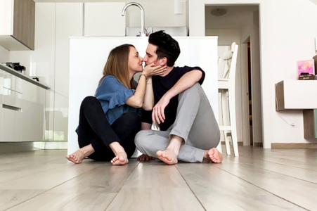An in-home Milano, Italyfacetime engagement shooting on the floor