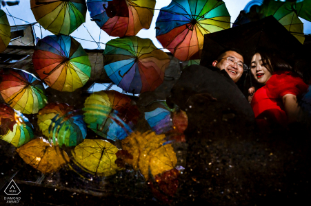 engagement shooting at istanbul turkey of couple among many colorful umbrellas