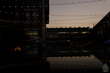 A nighttime engagement portrait at Ghirardelli Square