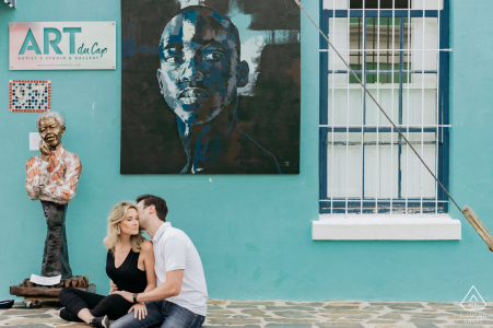 couple sitting while looking at Nelson Mandela image on an art building