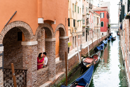 Prewedding engagement shoot at a canal with gondolas in Venice, Italy