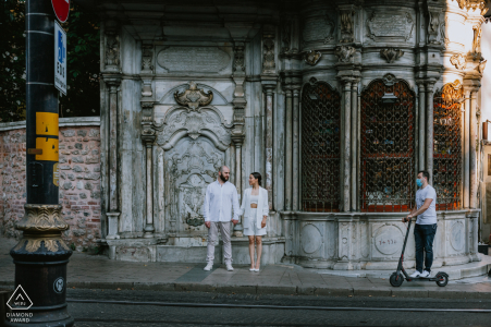 Couple in front of a historical fountain in Istanbul for their engagement portrait session