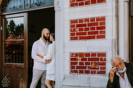 Couple posing in a doorway for an engagement portrait in Sultanahmet, Turkey