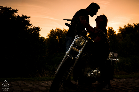 Nice sunset silhouette with a Harley motorcycle in Bovensluis Willemstad.